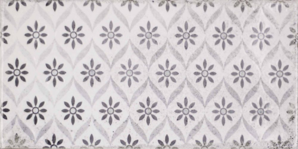 Harewood flower patterned worn look grey metro tiles