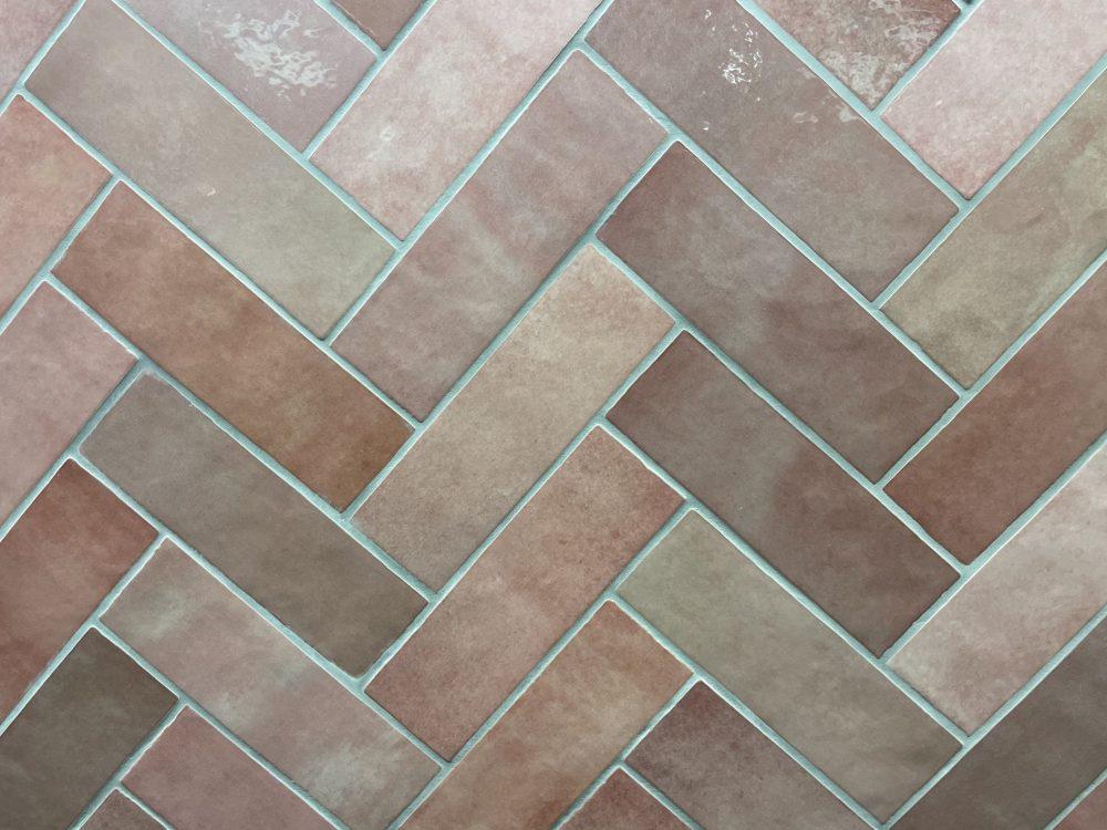 pink metro tiles laid in herringbone patter