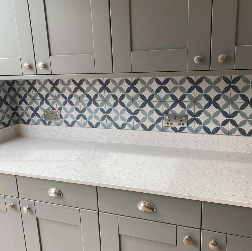 sage green patterned tiles